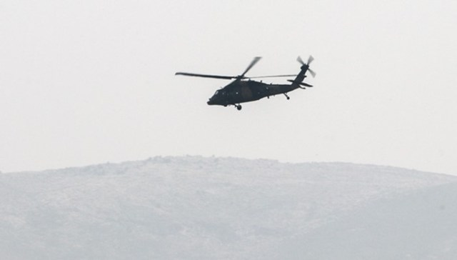 HATAY, TURKEY - FEBRUARY 09: Turkish Armed Forces' military helicopter is seen within the 'Operation Olive Branch' launched in Syria's Afrin, on February 09, 2018 over Hatay, Turkey. Turkey launched Operation Olive Branch on January 20 in Syria's northwestern Afrin region; the aim of the operation is to establish security and stability along Turkish borders and the region as well as to eliminate PKK/KCK/PYD-YPG and Daesh terror groups, and protect the Syrian people from the oppression and cruelty of terrorists. Burak Milli / Anadolu Agency